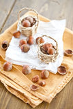 Little baskets filled with hazelnuts Stock Images