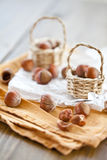 Little baskets filled with hazelnuts Stock Photo