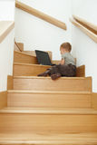 Little bay sitting on stairs Stock Photography