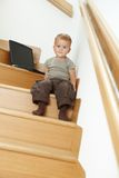 Little bay sitting on stairs Stock Image
