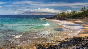 Little Beach Maui Sunrise. Little beach on the island of Maui, hawaii at sunrise with turquoise sea and a view of the west maui mountains before all the nudists royalty free stock photography