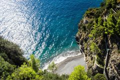 Little beach of mediterranean sea on Amalfi coast of Italy close Positano stock photography