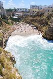 Little beach of Polignano a Mare with rough sea - Italy royalty free stock image