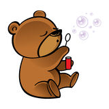 Little bear blowing bubbles in the air Stock Photos