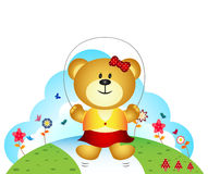 Little bear playing jump rope in the garden Royalty Free Stock Photography