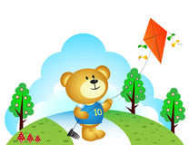 Little bear playing kites at the park Royalty Free Stock Images