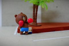 The little bear is practicing boxing. stock images