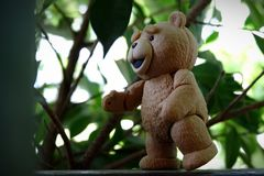 The little bear is going to find the leaves. royalty free stock photography