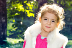 Little beautifu fashion girl closeup outdoors. Happy child face. Stock Photo