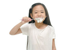 Little beautiful asian girl brushing teeth Stock Photography