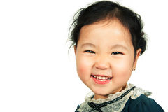 Little beautiful asian girl smiling. Isolated on white background. Close-up Royalty Free Stock Images