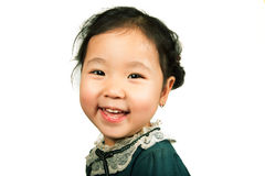Little beautiful asian girl. Smiling, isolated on white background. Close-up Stock Images