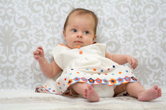 Little beautiful baby girl. Little baby girl in  dress in a white dress Royalty Free Stock Photography