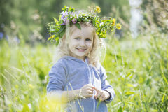 Little beautiful baby girl outdoors in a field in the fresh air. Happy Stock Photography
