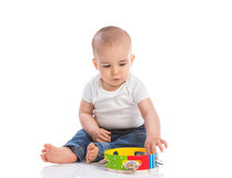 Little beautiful baby playing with tambourine Royalty Free Stock Photos