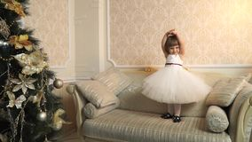 Little beautiful ballerina on the big couch stock video