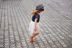Little beautiful barefoot girl in park Royalty Free Stock Images
