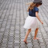 Little beautiful barefoot girl in park Royalty Free Stock Photography