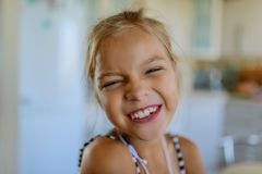 Little beautiful blionde smiling girl poses faces Royalty Free Stock Photography