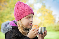Little beautiful blond girl eating cake Stock Photography