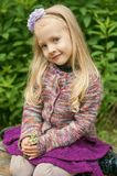 Little beautiful blond girl in nature stock image