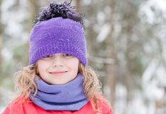 Little beautiful blond girl in winter outwear Stock Photography