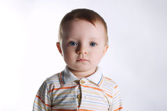 Little beautiful boy on bright background Royalty Free Stock Images