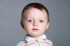Little beautiful boy on bright background Stock Photos