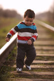 Little beautiful boy plays on railroad Stock Images