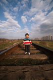 Little beautiful boy plays on railroad Royalty Free Stock Photography