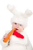 Little beautiful boy in rabbit costume with carrot Royalty Free Stock Photo