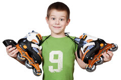 Little beautiful boy with roller skates Royalty Free Stock Photo