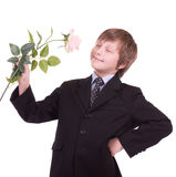 Little beautiful boy with roses Stock Image