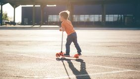 Little beautiful boy a scooter Royalty Free Stock Photo