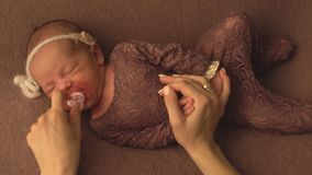 Little beautiful caucasian girl in elegant clothes sleeps in the studio and poses for a photo shoot, infant stock video