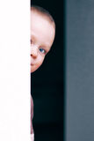Little beautiful child playing. Hide smiles thinking Stock Images