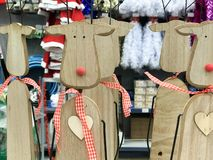 Little beautiful Christmas toy decorative wooden cute festive New Year`s deer with red noses. The background royalty free stock photo