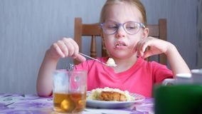 Little beautiful cute girl doesn`t want eating mashed potatoes. Little beautiful cute girl doesn`t want eating a mashed potatoes at the table in the kitchen stock video