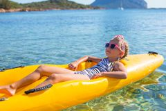 Little beautiful cute girl enjoy kayaking in the Royalty Free Stock Photo