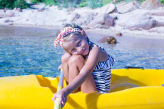 Little beautiful cute girl kayaking in the clear Royalty Free Stock Images