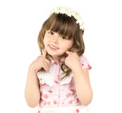 Little beautiful girl. The small beautiful girl smiles, Has bent hands upwards in elbows,  touched fingers  in cheeks, on a white background Royalty Free Stock Photos