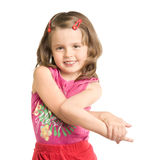 Little beautiful girl. The small beautiful girl has fancifully bent hands, smiles, on a white background Stock Images
