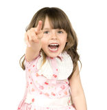 Little beautiful girl. The small beautiful girl is dared, shouts, shows a finger of a hand in a direction of a camera, on white background. Profile Adobe RGB ( Stock Photos