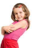 Little beautiful girl. The small beautiful girl has fancifully bent hands, smiles, on a white background Royalty Free Stock Photos