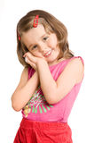 Little beautiful girl. The small beautiful girl has fancifully bent hands, smiles, on a white background Stock Photo