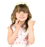 Little beautiful girl. The small beautiful girl smiles, Has bent hands upwards in elbows,  touched fingers  in cheeks, on a white background.  Profile Adobe RGB Stock Photo