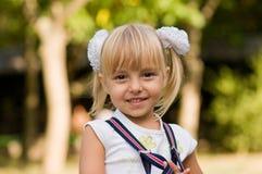 Little beautiful girl. Portrait of little beautiful girl wearing suspenders Stock Images