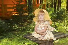 Little beautiful girl. Little beautiful girl in the country in the summer among the trees stock photography