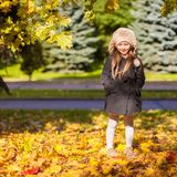 Little beautiful girl on the autumn meadow in a Royalty Free Stock Photography