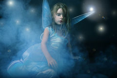 Little beautiful girl in blue dress with wings. Royalty Free Stock Images